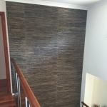 Black grasscloth wallpaper in stairwell - Broadbeach Waters