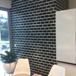 Underwood wallpaper installation using black brick wallpaper