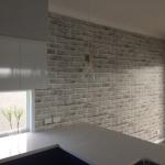 White brick wallpaper installation Calypso Bay Jacobs Well