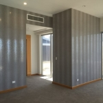 silver metallic wallpaper installation in penthouse Surfers Paradise