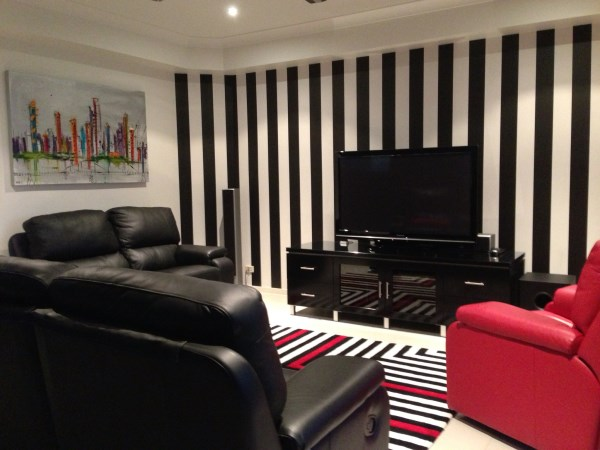 Striped wallpaper fits in with any style for Black and white striped wallpaper living room