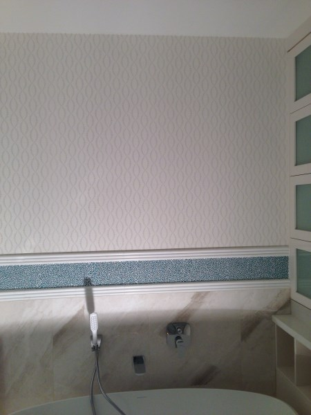 wallpaper hanging in bathroom of Byron Bay house
