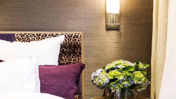Dee's grasscloth wall with leopard bed