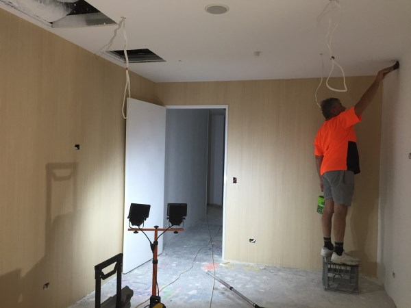department store wallpaper installation using timber grain wallpaper
