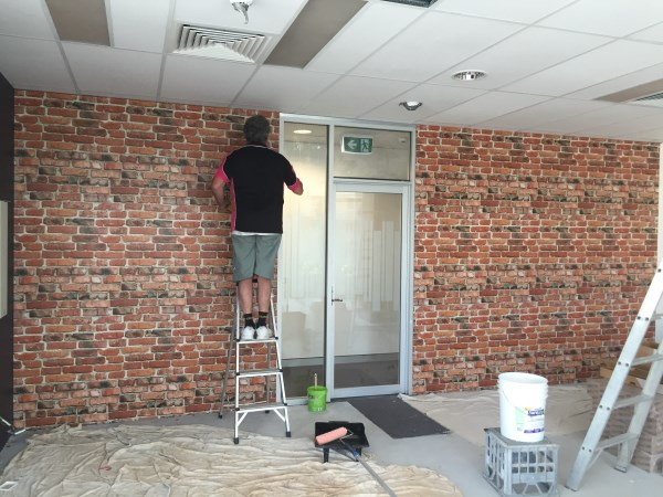 commercial office brick wallpaper before
