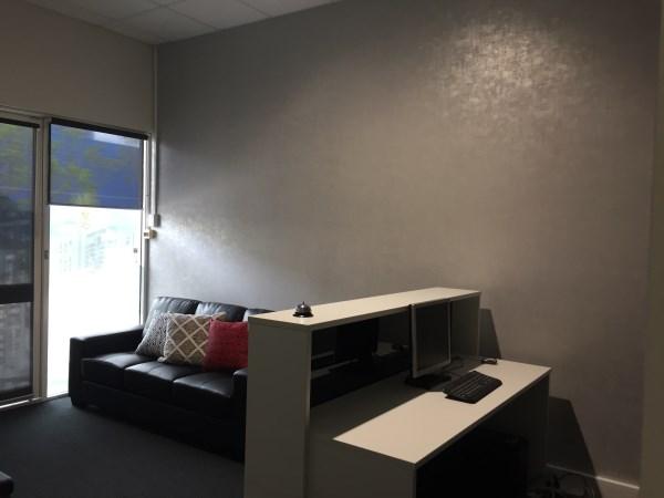 reception area using grey vinyl wallpaper